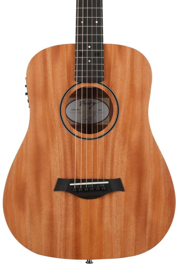 The Baby Taylor BT2e is our pick as the best guitar for small hands.
