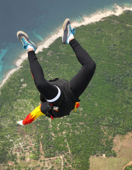 A skydiver jumping from a plane.