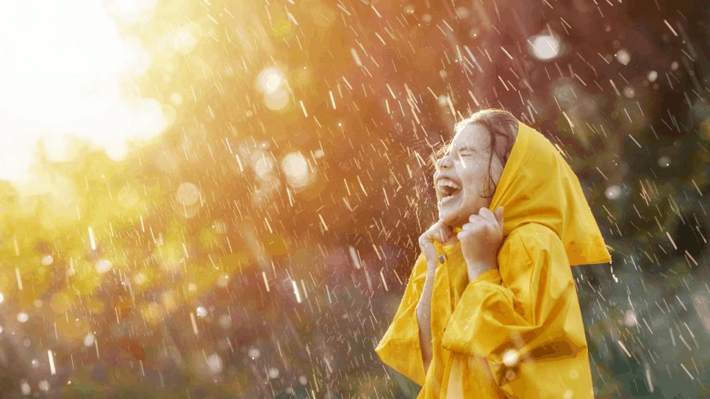 Girl playing in the rain.
